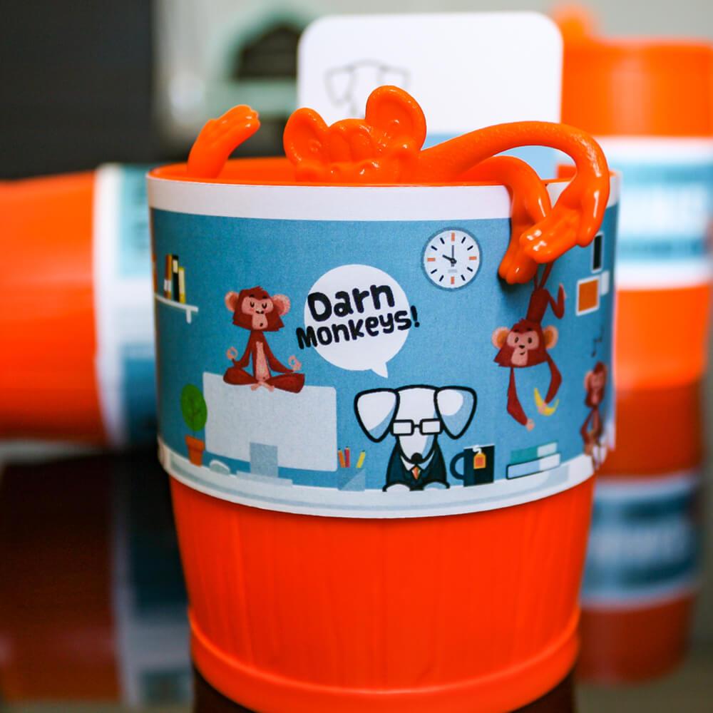 orange barrel of monkeys