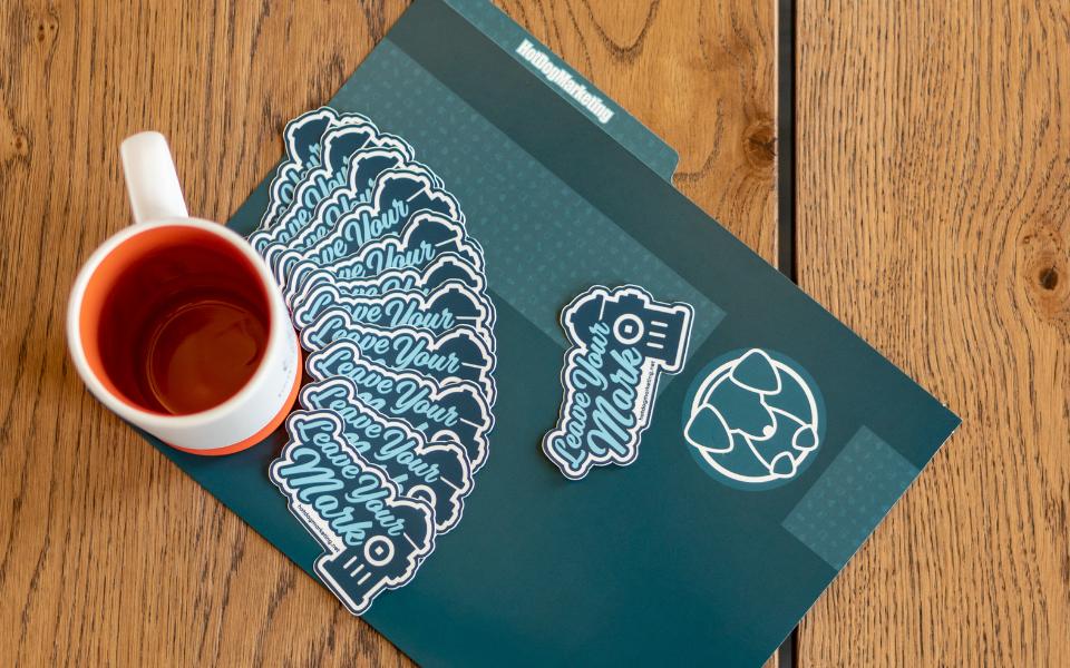 Brand-Equity-Featured-Image-Hot-Dog-Marketing-Folder-Leave-Your-Mark-Stickers-Mug
